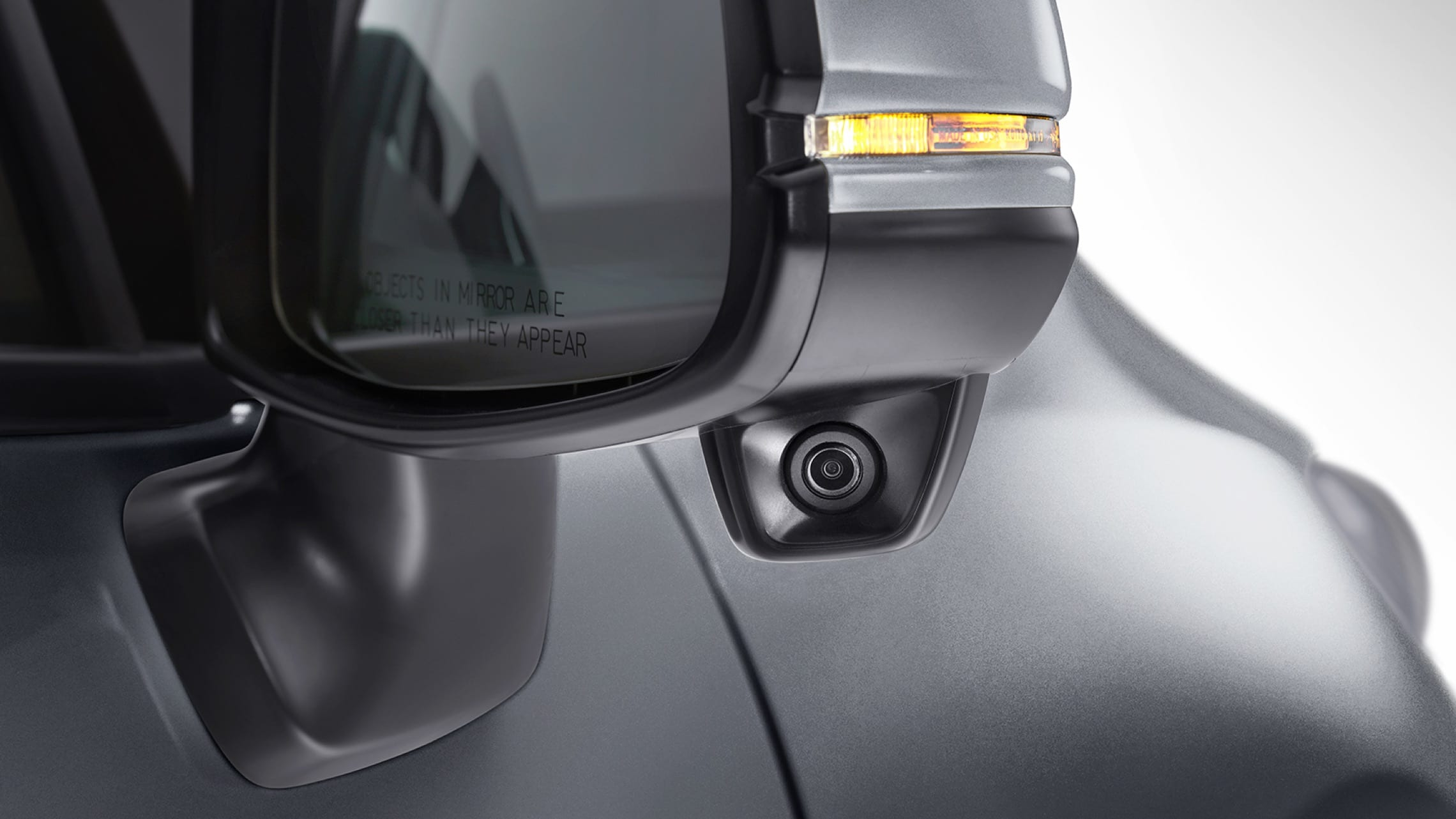 Exterior close up view of Honda LaneWatch™ feature on passenger side mirror on 2020 Honda Fit EX-L.